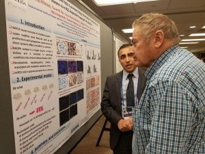 Firas explaining his latest findings to Dr. Mason